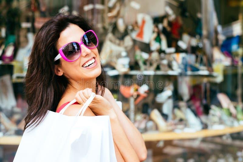 Joyful fashion woman shopping stock photography