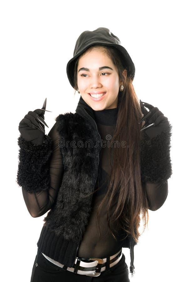 Joyful flicka i handskar med jordluckrare. Isolerat royaltyfria foton