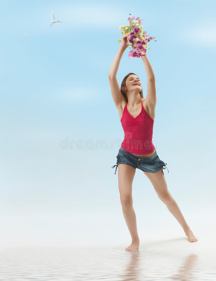Joyful girl. Girl with flowers feels light and free royalty free stock photography