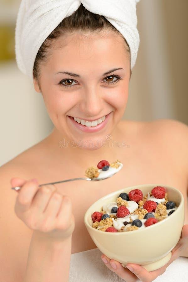 Download Joyful Girl Eating Muesli For Breakfast Stock Photo - Image: 30732674