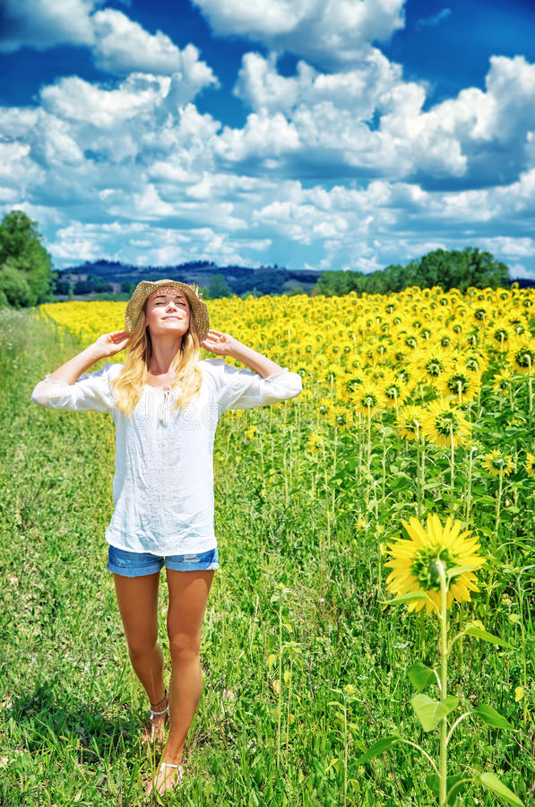Free Joyful Girl In Sunflowers Field Royalty Free Stock Photography - 44446837
