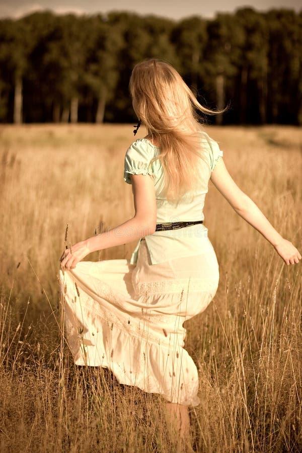 Download Joyful Girl Walking On A Field Stock Photo - Image of beautiful, fields: 2467924