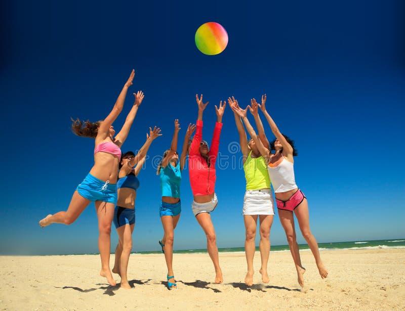 Joyful Girls Playing Volleyball Stock Photos