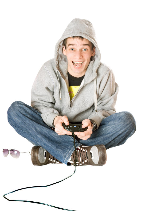 Joyful guy with a joystick. For game console stock images
