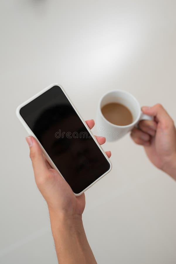 Joyful guy messaging on mobile phone.  royalty free stock photography