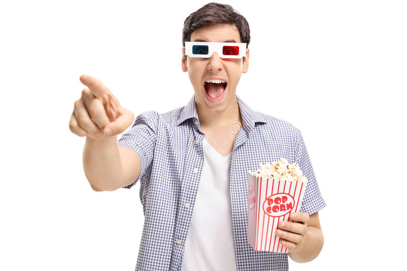 Joyful guy with a pair of 3D glasses and popcorn laughing. Joyful guy with a pair of 3D glasses and popcorn pointing at the camera and laughing on white stock photos