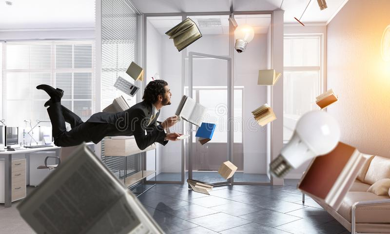 Joyful happe businessman levitating horizontally stock photography