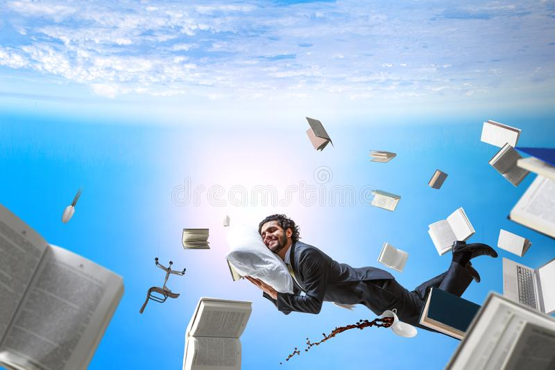 Joyful happe businessman levitating horizontally stock photos