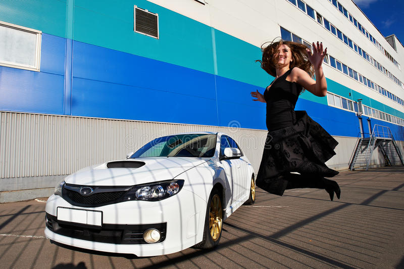 Download Joyful Happy Girl Jumping Near White Car Royalty Free Stock Photo - Image: 18148915