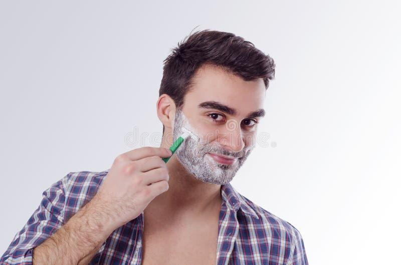 Joyful happy man shaving in the morning stock photos