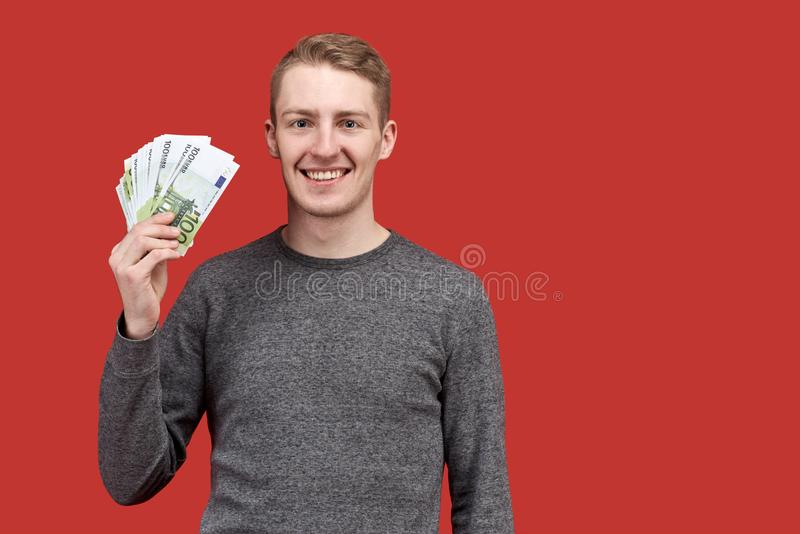 Joyful happy successful man looking into the camera with a wide smile of white teeth. royalty free stock photo