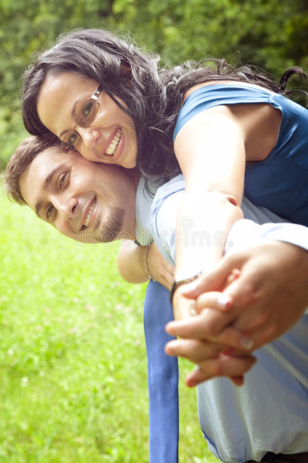 Joyful happy young couple playing outdoor royalty free stock image