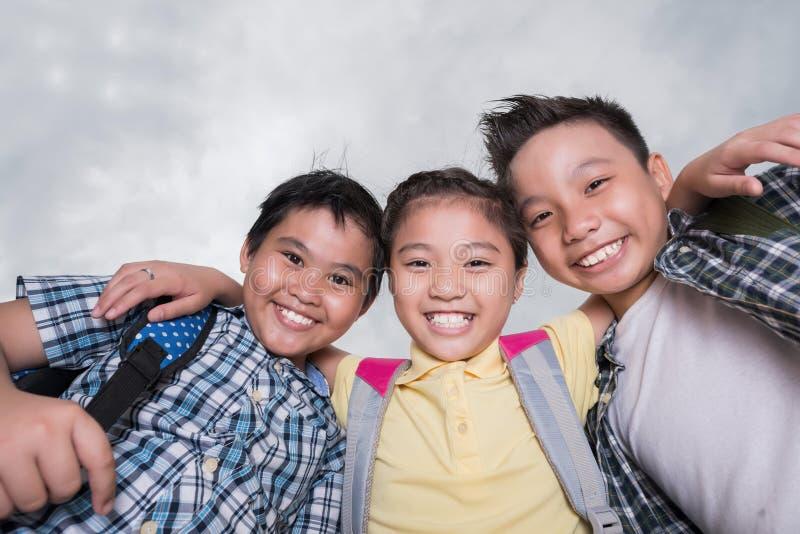 Joyful hugging kids royalty free stock images