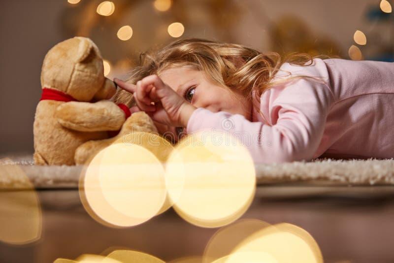 Joyful little child playing with toy stock photo