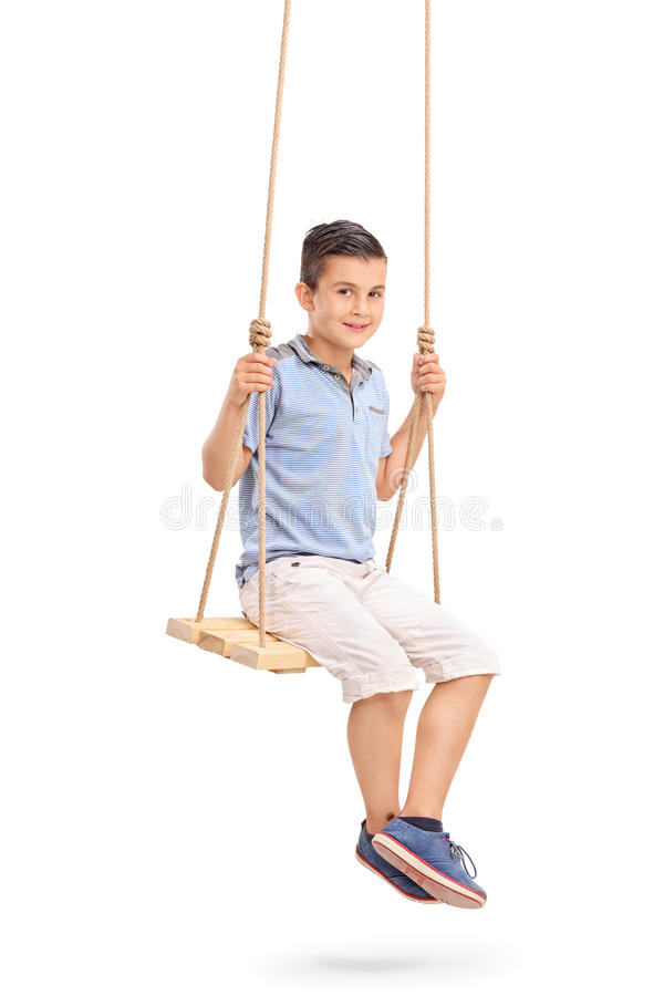 Joyful little kid sitting on a swing stock photos