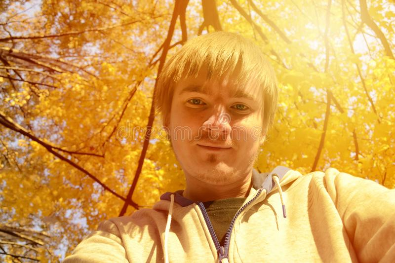 Joyful man selfie in sunny autumn day. royalty free stock photos