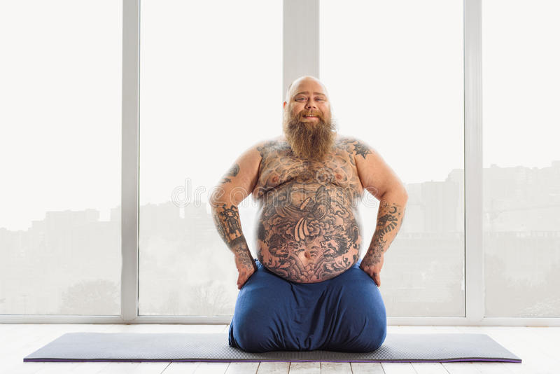 Download Joyful Mature Fat Man Doing Yoga At Home Stock Image