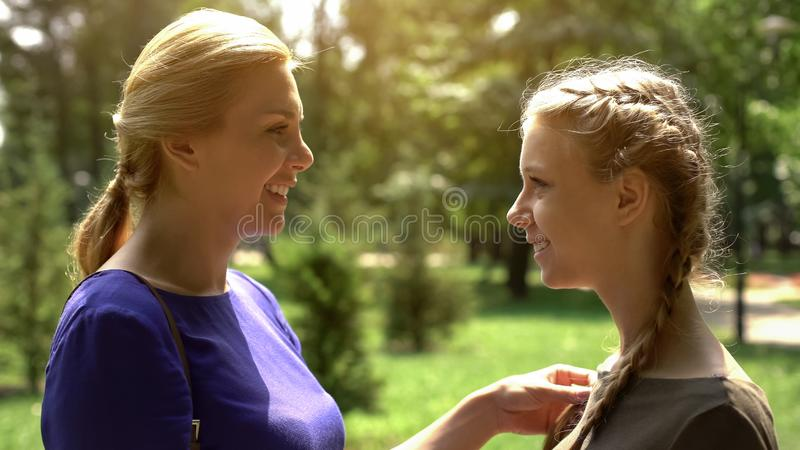 Joyful mother and daughter looking at each other with love and tenderness, trust royalty free stock photo