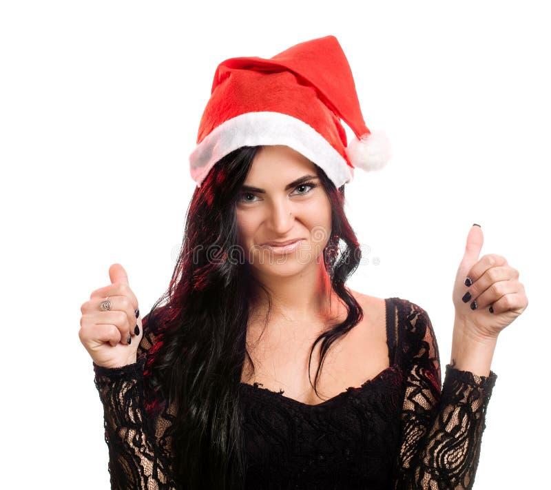 Joyful nätt kvinna i den röda Santa Claus hatten royaltyfri fotografi