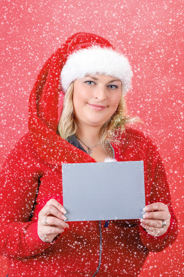 Download Joyful Pretty Woman In Red Santa Claus Hat Smiling With Snowflakes Stock Image - Image: 29291591