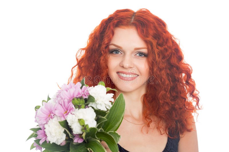 Joyful red haired girl with flowers stock photography