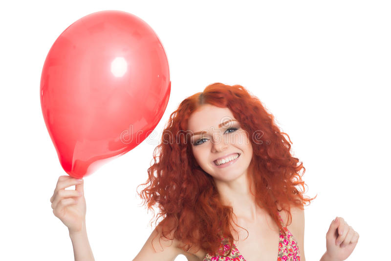 Joyful Redhead Girl Holding Red Balloon Stock Photo