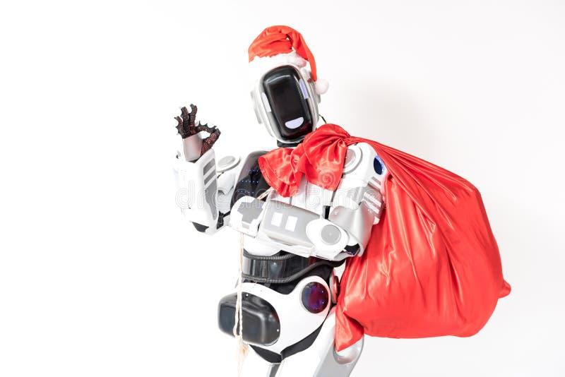 Joyful robot is wearing Santa Claus cap stock photo
