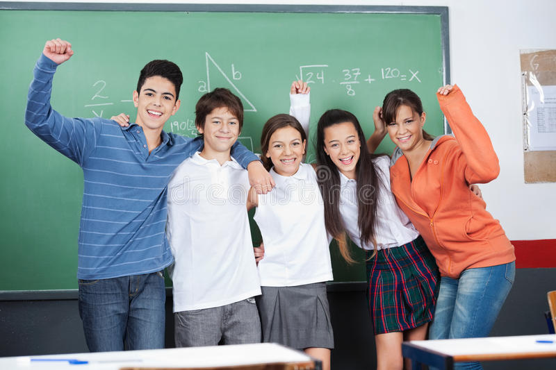 Joyful Schoolchildren Standing Together In stock photos