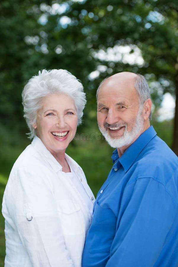 Joyful senior couple enjoying nature stock photography
