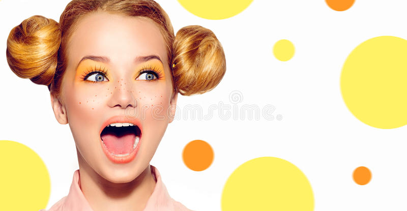 Joyful teen girl with freckles, funny red hairstyle. And yellow makeup royalty free stock photos
