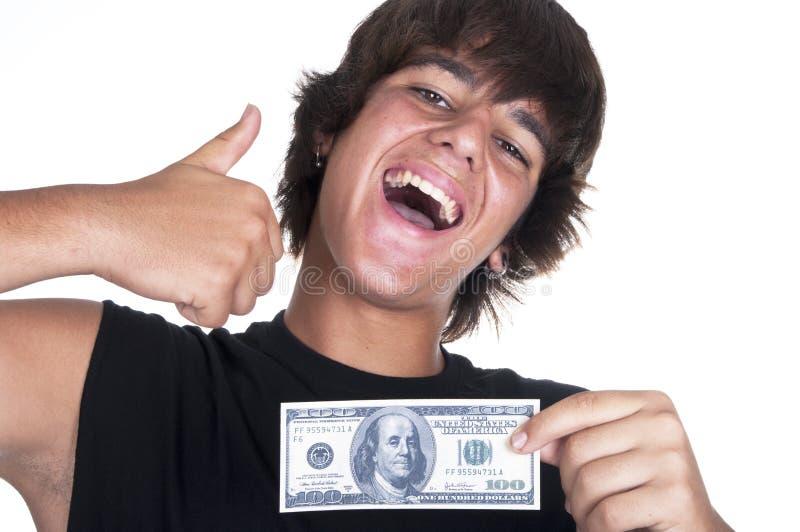 Joyful teenager with $ 100 bills stock image