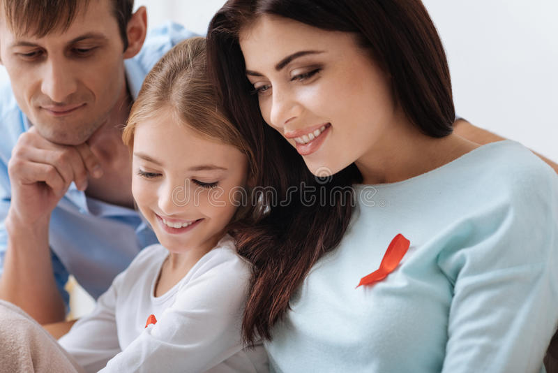Joyful united family having great time together. Great mood. Joyful pleasant united family sitting together and smiling while enjoying their time together stock photos