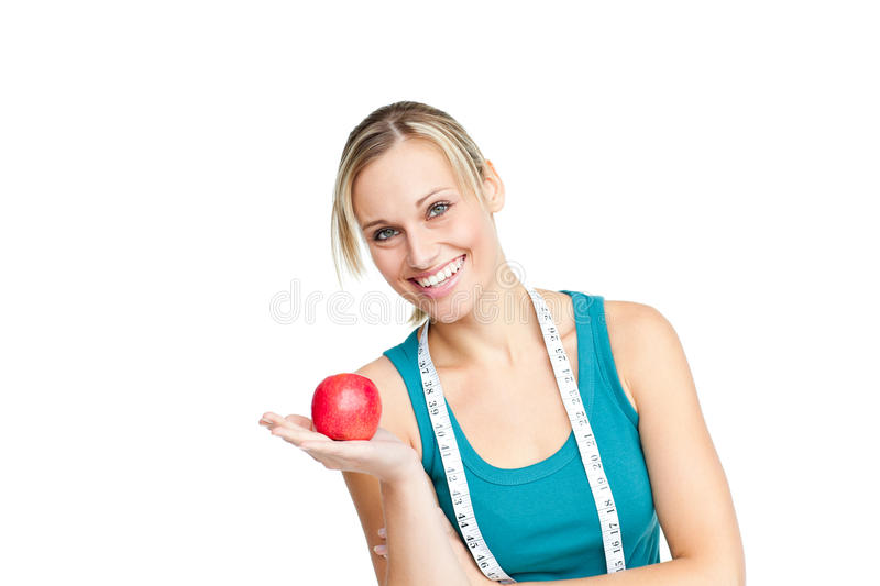 Download Joyful Woman With An Apple And A Measuring Tape Stock Image - Image: 16347839