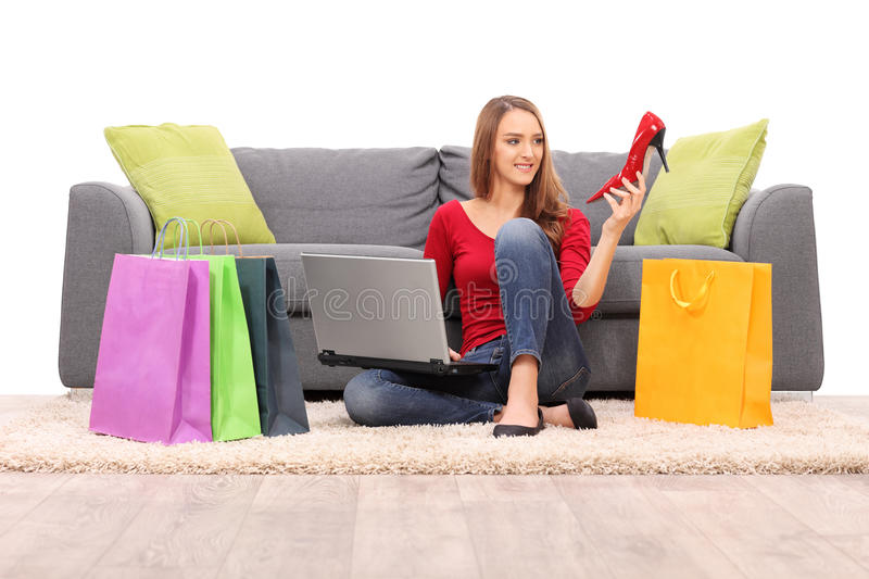 Joyful woman buying shoes online royalty free stock photos