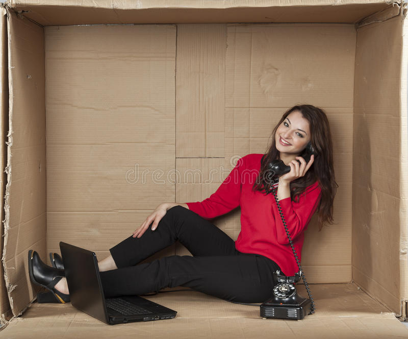 Joyful woman in a call center stock image