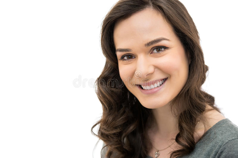 Joyful woman. Closeup of smiling girl looking at camera isolated on white background royalty free stock photos