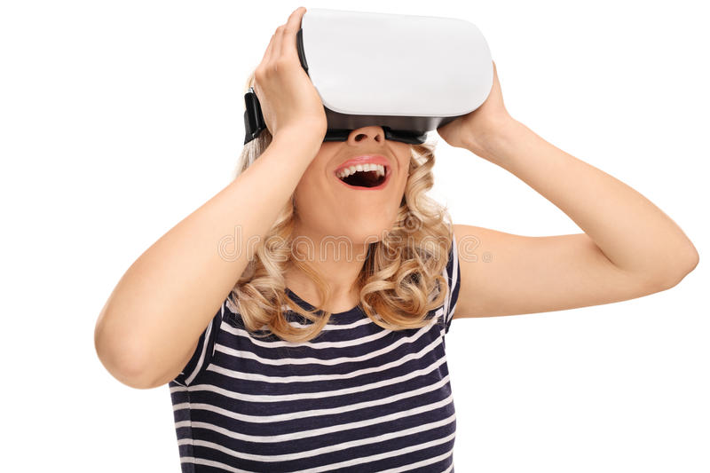 Joyful woman experiencing virtual reality. Through VR headset isolated on white background stock images