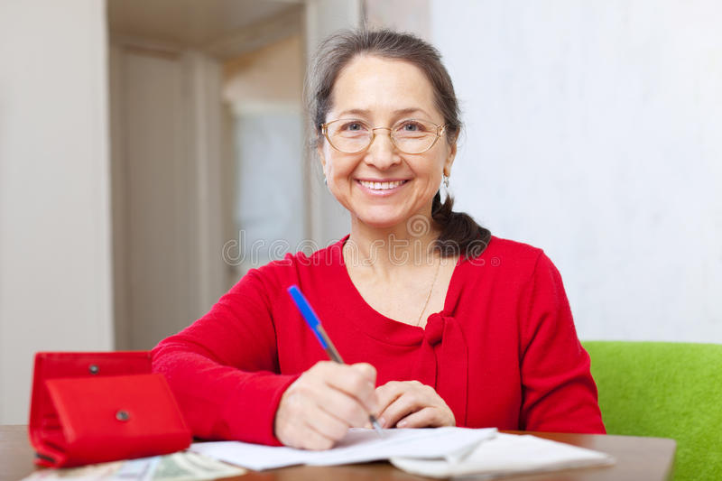 Download Joyful Woman Fills In The Questionnaire Stock Image - Image: 29233519