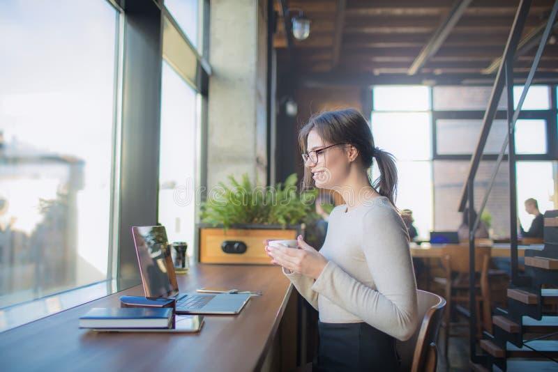 Joyful woman freelancer having online video call via notebook device royalty free stock image