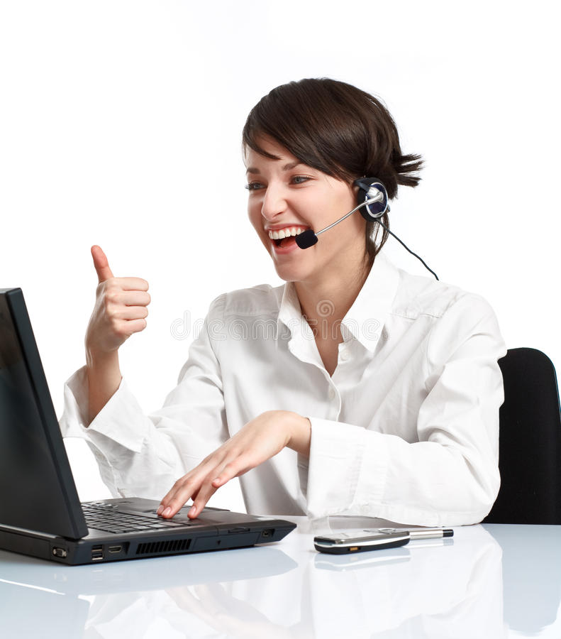 Joyful woman operator with headset showing OK. Joyful woman operator with headset (microphone and headphones) showing OK and laughing stock images
