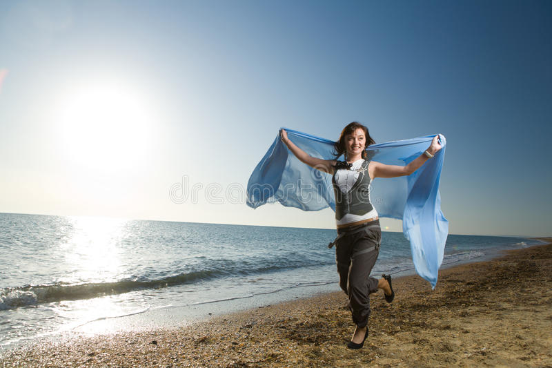 Download Joyful Woman Running At Sea Shore Stock Image - Image: 13251267