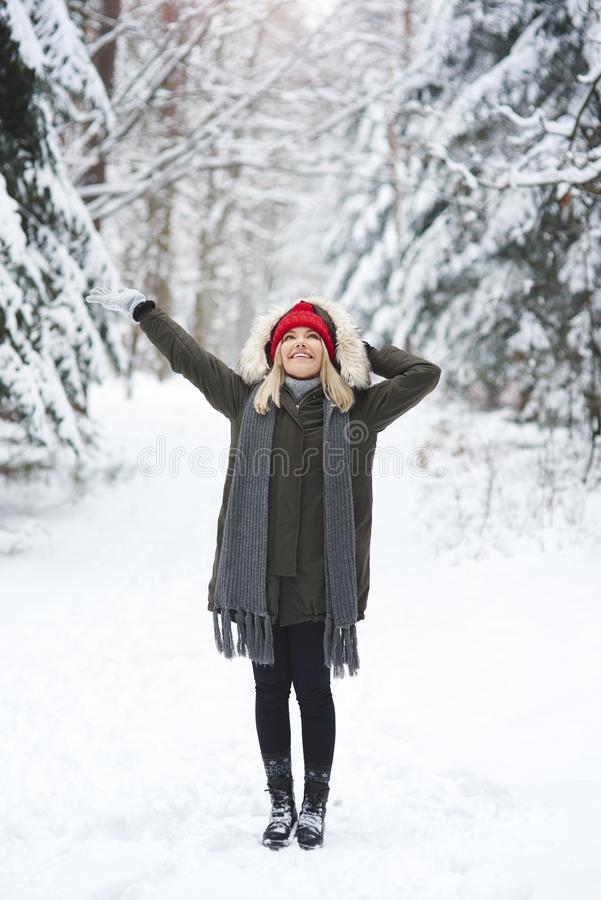 Joyful woman in winter time royalty free stock photography