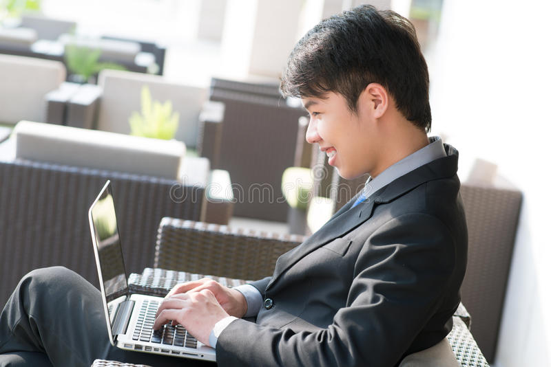 Joyful worker. Joyful business worker communicating via laptop during the break stock photo