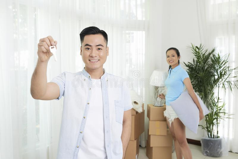 Joyful young family in apartment stock image