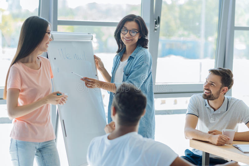 Joyful young people attending a training seminar. Professional qualification. Joyful smart young people smiling and learning new information while attending a royalty free stock images