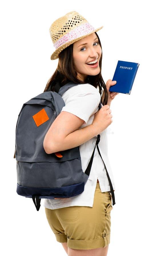 Joyful young traveler holding passport isolated on white background. Joyful young woman traveler holding passport smiling stock photography