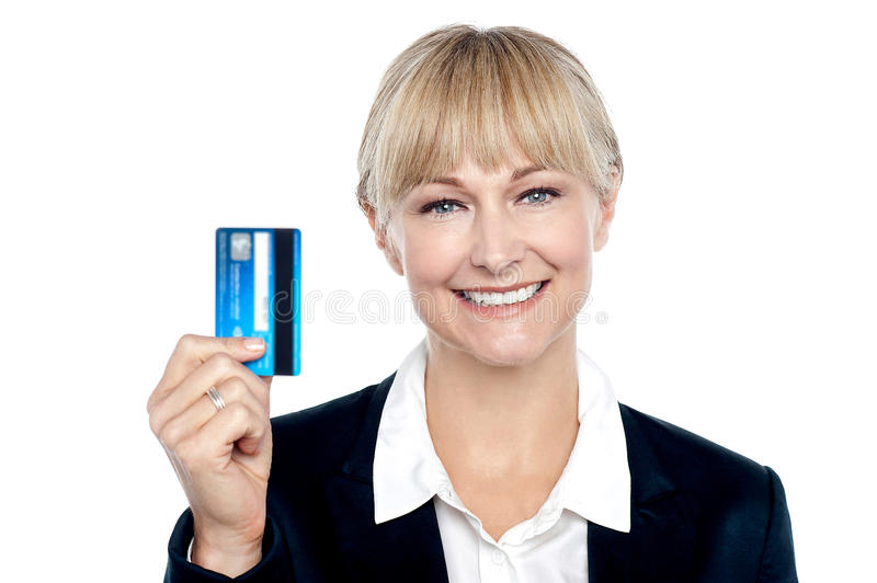Joyous Female Employee Showing Credit Card Stock Photo