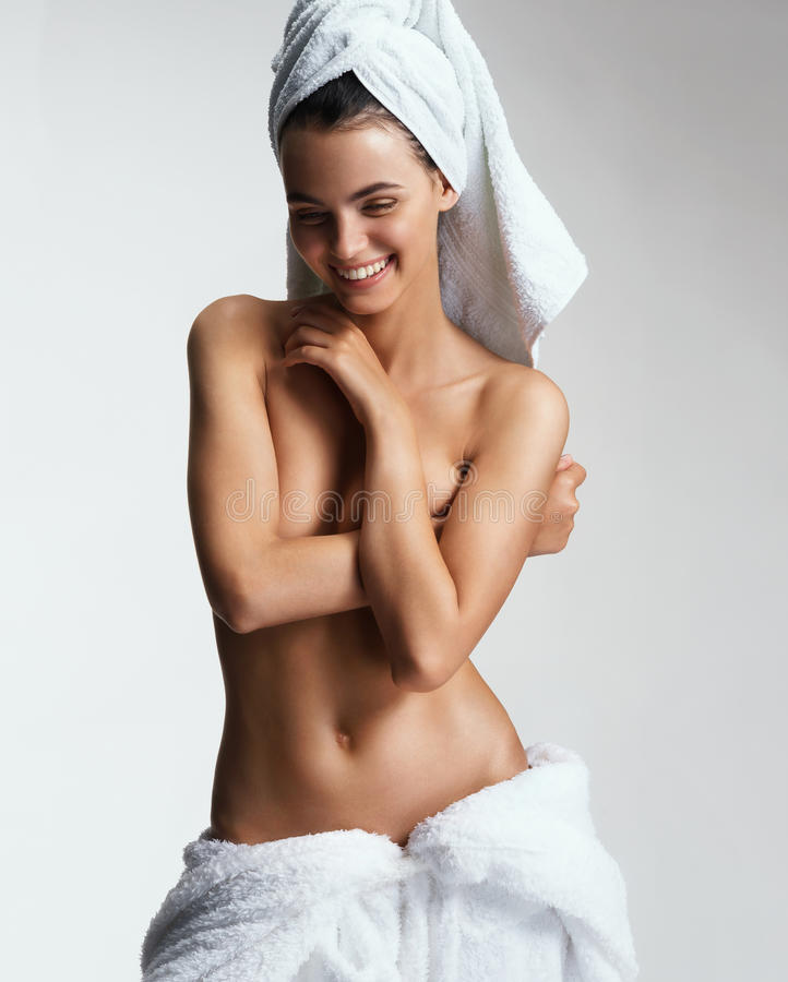 Joyous girl with tanned body after spa. stock photos