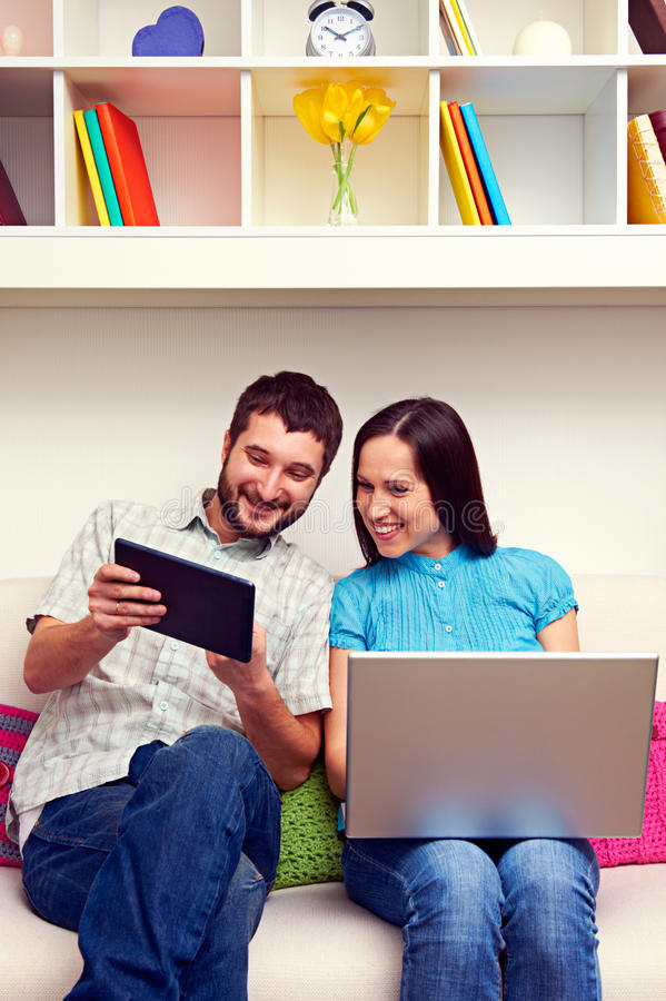 Man and woman looking at the tablet pc stock image