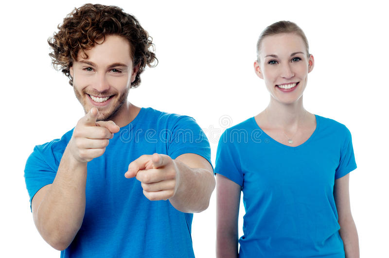 Joyous young couple having fun stock images